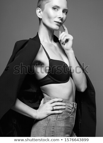 beautiful blonde woman in bra with jeans shorts. Stock photo © Pilgrimego