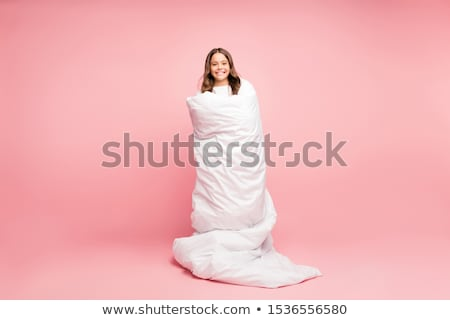 Beautiful woman in pink cosy sleepwear on the bed. Stock photo © Pilgrimego
