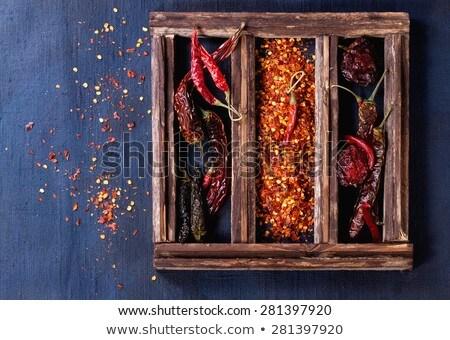 Red birds eye chilli over white Stock photo © lucielang