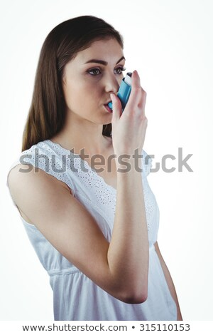 Pretty woman using her inhaler Stock photo © wavebreak_media