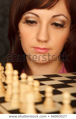 Girl with the sad looks on the chessboard. Close-up. Vertical format. Indoor. Stock photo © Paha_L