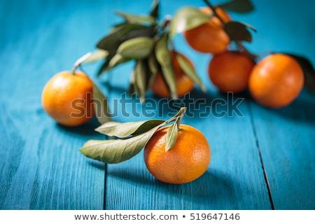 Fresco tangerina azul tabela comida madeira Foto stock © radub85