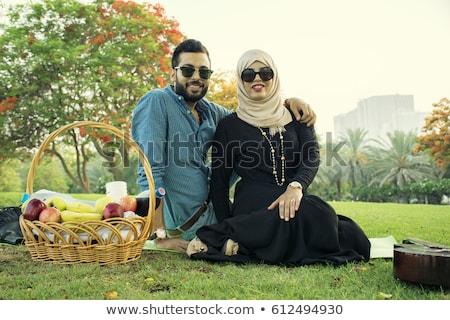 Muslim couple man and woman smiling outdoors Stock photo © zurijeta