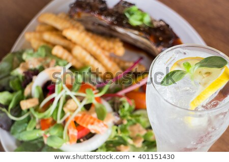 Delicious barbecued ribs and lemon soda drink Stock photo © nalinratphi