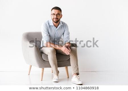 Uomo d'affari sedia bianco indossare suit ufficio Foto d'archivio © Yatsenko