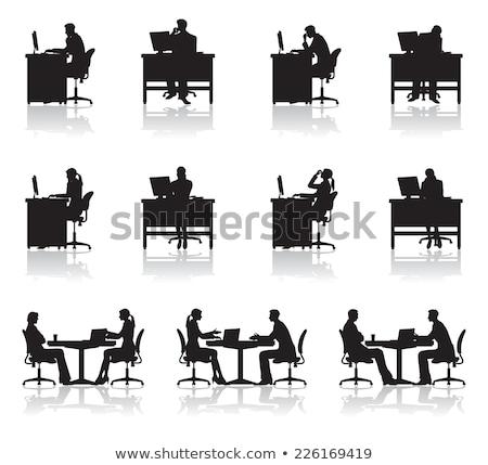 Tired businesswoman sitting at desk Stock photo © wavebreak_media