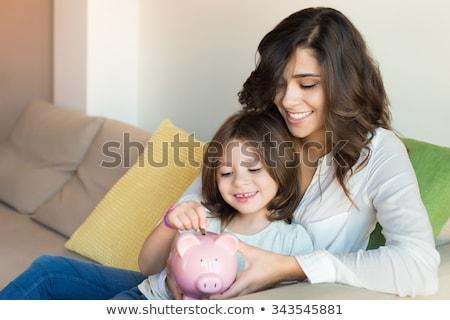 Fiatal család kanapé költségvetést készít nő lány Stock fotó © IS2