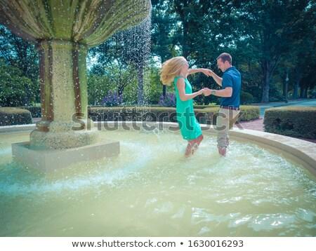 Iki romantik çiftler çeşme seyahat eğlence Stok fotoğraf © IS2