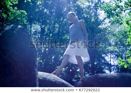 woman walking on a big roc stock photo © is2