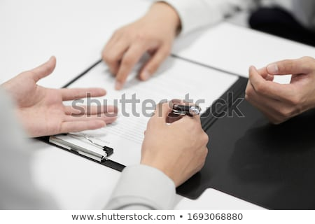 Asian businessmen sign a contract Stock photo © studioworkstock