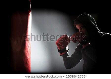 Karate player practicing on punching bag Stock photo © wavebreak_media
