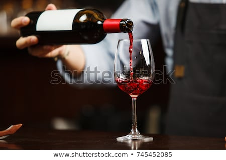 Wine pouring in wineglass Stock photo © Givaga