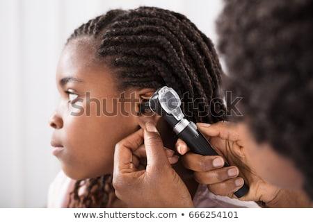 Doctor Checking Girl's Ear Stock photo © AndreyPopov