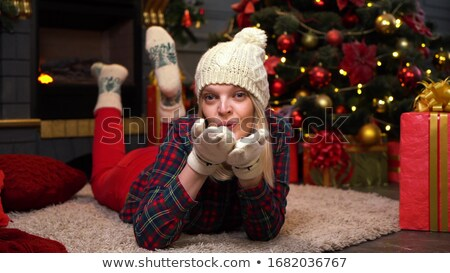 Portrait of a young woman lying on white plaid with christmas gi Stock photo © MikhailMishchenko