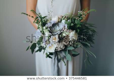 Beautiful bridal bouquet on a green grass stock photo © ruslanshramko