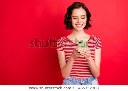 Göndör haj tinilány sms üzenetek otthon telefon Stock fotó © boggy