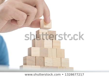 man placing the last brick on top of the stack stock photo © feedough
