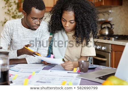 young man frustrated at his house and tax bills stock photo © elnur