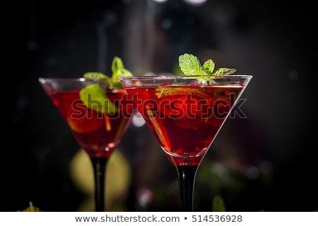 Kettő szemüveg martini koktél zöld olajbogyók Stock fotó © Alex9500