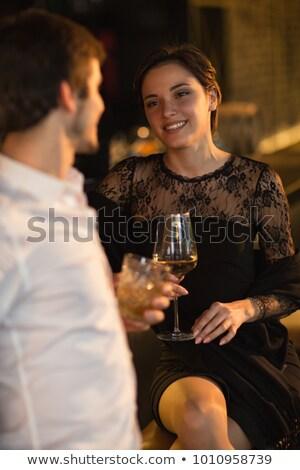Donna bere vino uomo ristorante Incontri Foto d'archivio © dolgachov