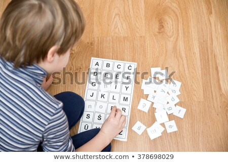 children learning letters at school lesson with teacher stock photo © robuart