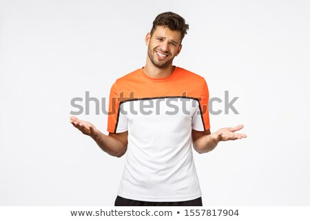 Arrogant, self-centered handsome macho man in good shape, spread hands sideways and making skeptical Stock photo © benzoix