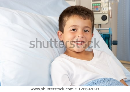 Boy Relaxing in pediatric hospital Stock photo © Lopolo