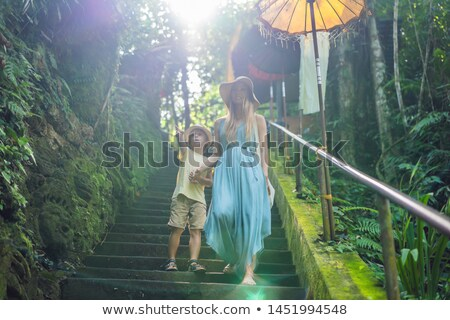 Mom and son tourists in Bali, Indonesia. Traveling with kids concept. What to do with children. Chil Stock photo © galitskaya