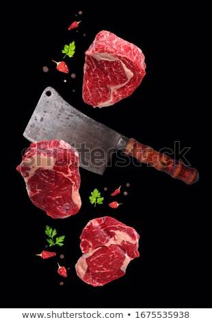 Crudo filete alimentos levitación cuchillo aislado Foto stock © furmanphoto