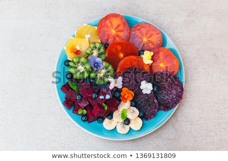 Top view of tropical fruit assortment on plate against white background. Fresh slices of dragon frui Stock photo © vkstudio
