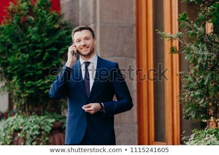 Angenehm schauen froh Geschäftsmann Gespräch Smartphone Stock foto © vkstudio