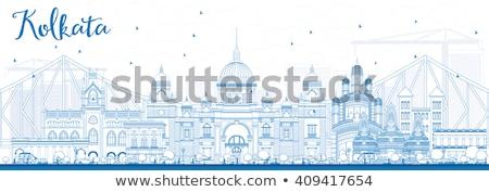 Outline Kolkata Skyline with Blue Landmarks. Stock photo © ShustrikS