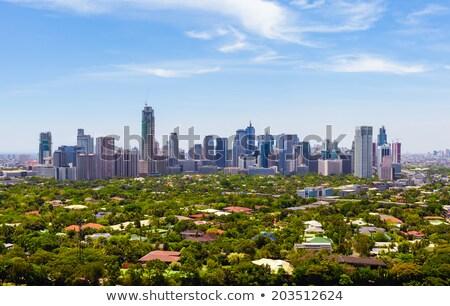 Manila linha do horizonte cor edifícios blue sky reflexões Foto stock © ShustrikS