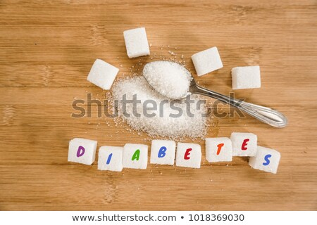 Close-Up shot of natural brown refined sugar cubes on white background. macro Stock photo © DenisMArt