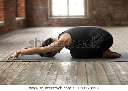 Sporty fit woman practices yoga asana Balasana Stock photo © dmitry_rukhlenko