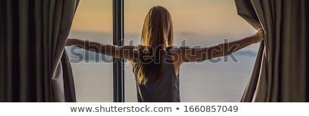 Gyönyörű nő függönyök ház karok hatalmas panorámakép Stock fotó © ruslanshramko
