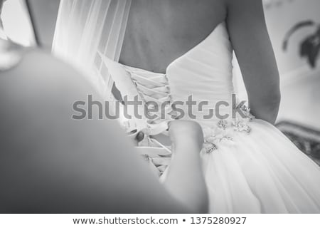 white garter dressed on the bride stock photo © pilgrimego