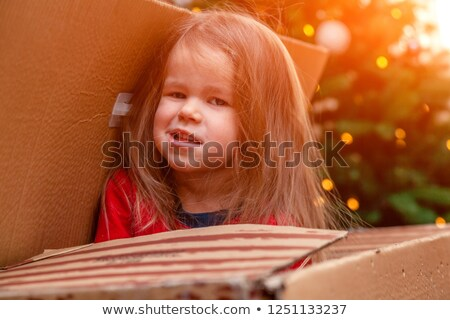 portrait of mischievous little girl posing with toy Stock photo © photography33