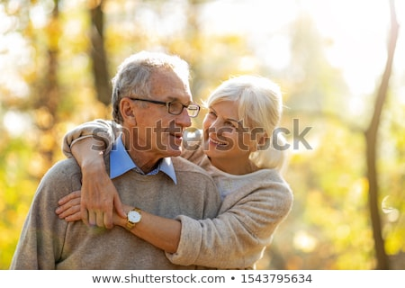Stock photo: Couple Embracing In The Park