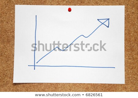A hand drawn positive profits chart on a cork notice board. Stock photo © latent