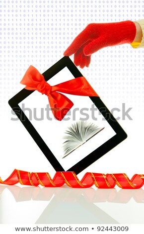 hands wearing red gloves holding a tablet pc stock photo © andreykr