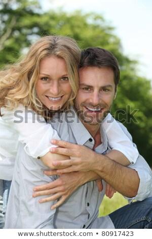 Happy couple sat by tree Stock photo © photography33