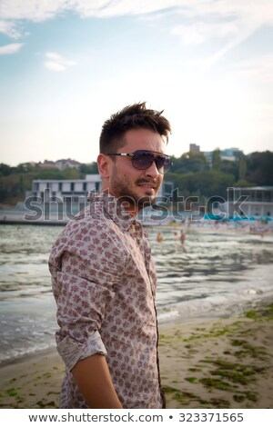 Mediterrán jóképű férfi napszemüveg fából készült sarok szexi Stock fotó © lunamarina
