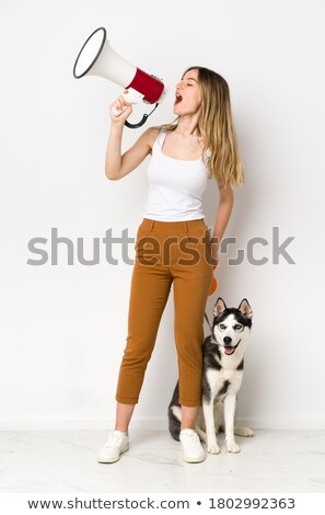Woman screaming on her friend with a bullhorn Stock photo © photography33