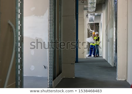 Architect and builder on site with plans Stock photo © photography33