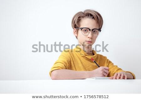 Iskolás fiú ír notebook nagy citromsárga színesceruza Stock fotó © stockyimages