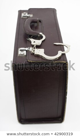 leather suitcase from pinned open handcuffs Stock photo © ozaiachin