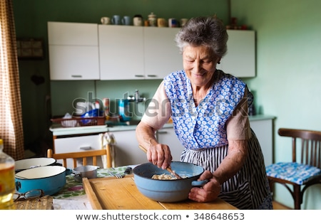 woman cooking with her grandmother stock photo © photography33
