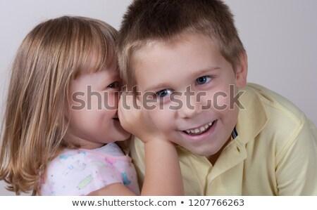 Dziewczynka tajne uśmiech twarz dziecko zabawy Zdjęcia stock © photography33
