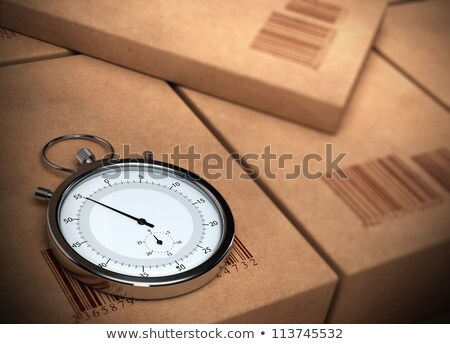 Foto d'archivio: Stopwatch Over A Carton Boxes